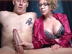 Wild mature girl near blondie hair with the addition of glasses is groping manhood in front of the camera