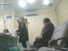 peeping chinese woman as a remedy for the hospital for an injection.1