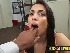 Hideous darkhaired babe blowing a massive black penis