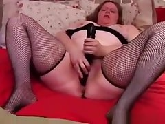 Sexy BBW amateur in fishnet stockings has a nice big clit