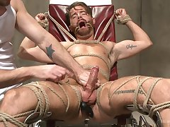 Submissive man endures rough gagging and anal sex