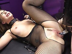 Woman in off colour fishnets, rough femdom XXX display