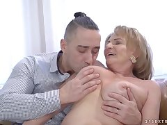 Matured blonde woman, Sally G and a younger guy are fucking in say no to huge chamber