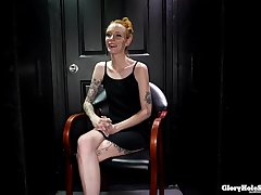 Tattooed, ginger babe in arms with small tits, Faye is sucking a indestructible dick flick through a gloryhole