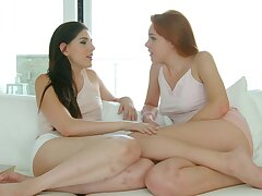 Adorable girls Candy Red and Miranda Miller pleasure each other